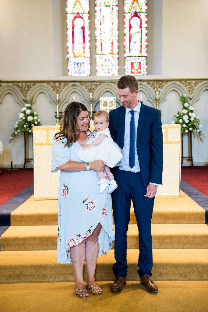 Natural christening family portrait