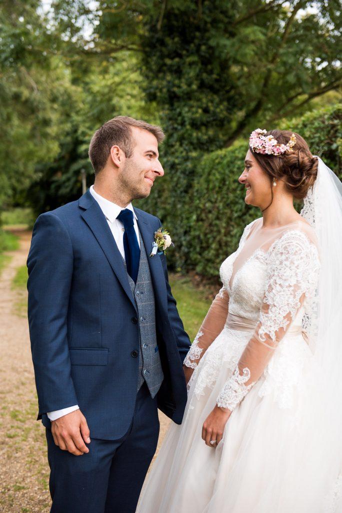Natural wedding portrait bride wearing Jay West Bridal dress Norfolk Barn wedding