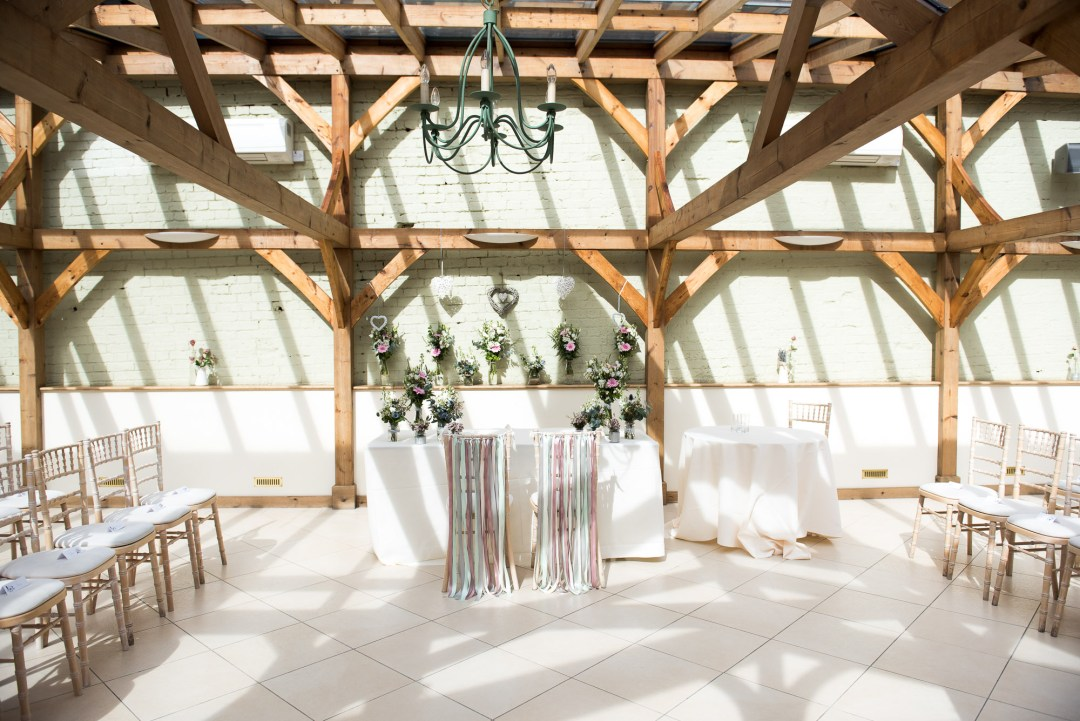 Gaynes Park conservatory filled with wedding details