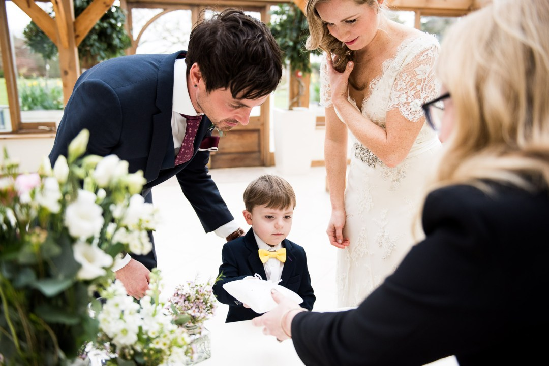 little ring bearer gives away the rings to registrar