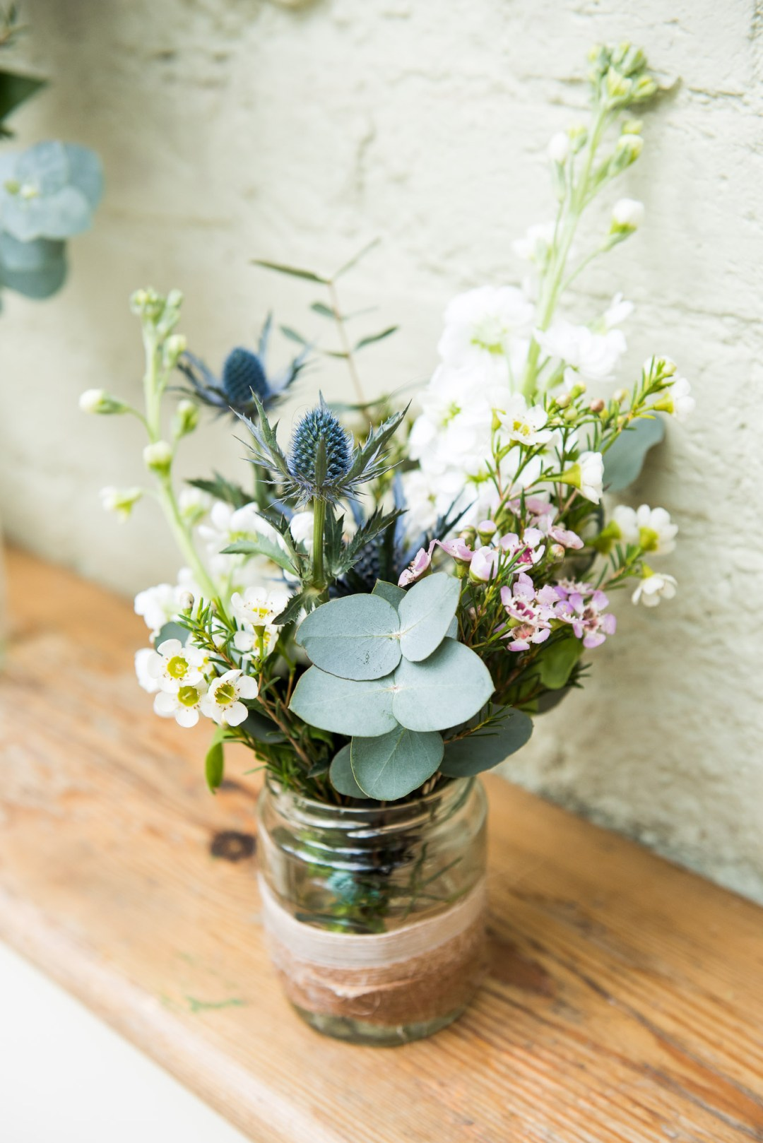 Natural eucalyptus and wax flower floral arrangement