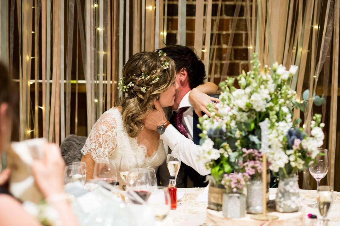 bride and groom embracing Essex Barn wedding