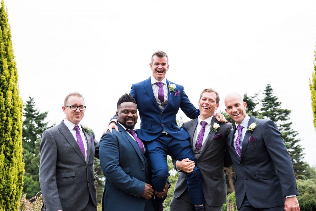 Groom with groomsmen wedding photography Surrey