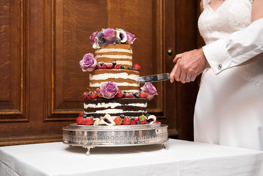 Cutting the cake Surrey wedding photography