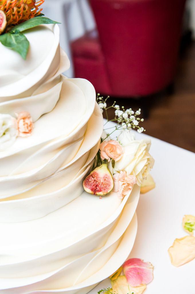 Stunning three tier white wedding cake with sugar decorations London