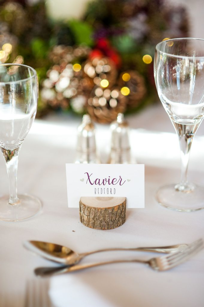 Ashridge House Wedding. Natural Wedding Photography. Natural floral tone centre pieces with wooden table place settings.