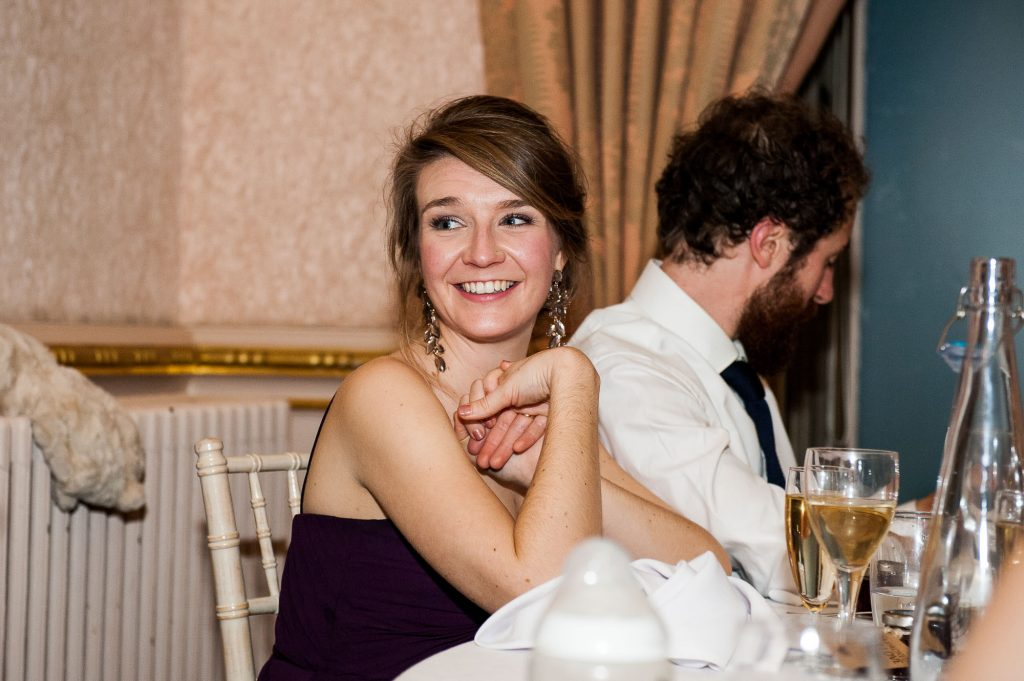 Ashridge House Wedding. Natural Wedding Photography. Bridesmaid reaction to wedding speeches.