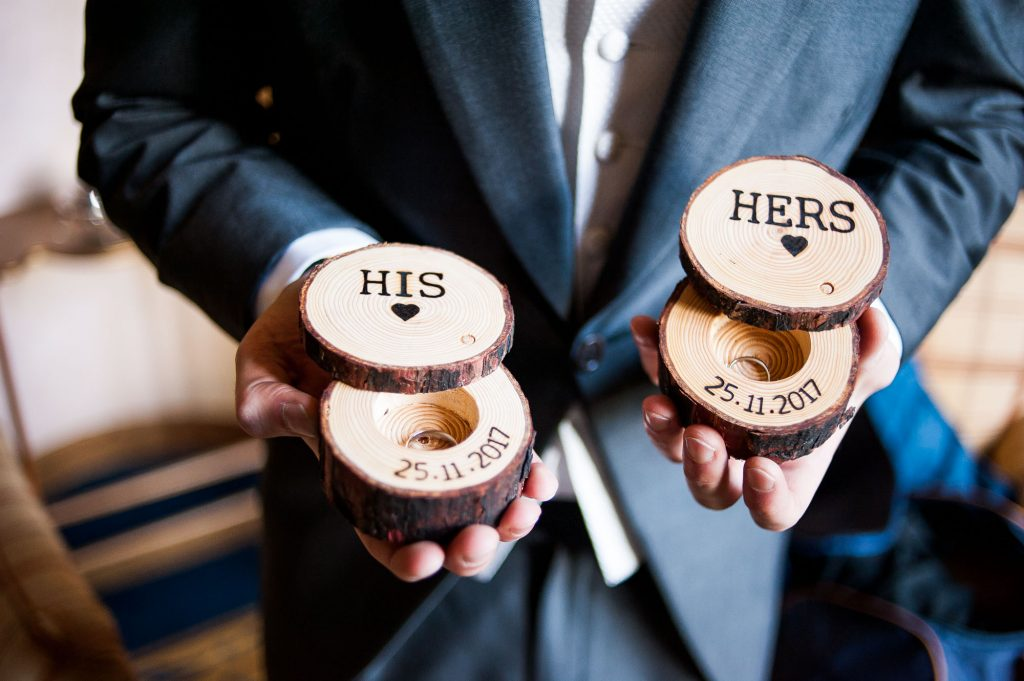 Ashridge House Wedding. Natural Wedding Photography. Documentary Groom preparation photography, groomsmen displays the rings in handmade wooden boxes.