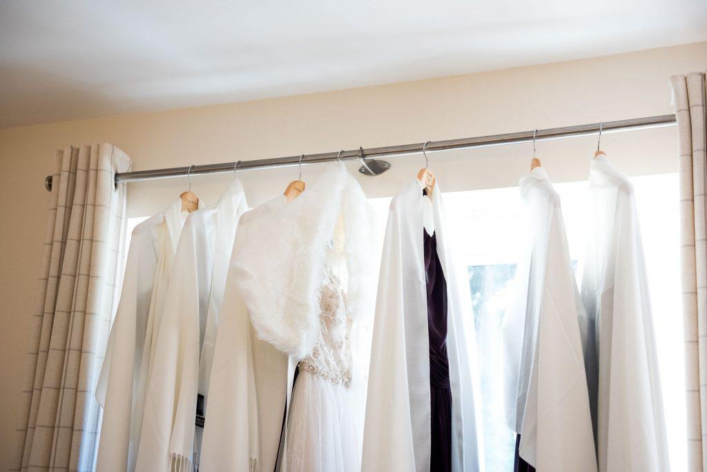 Ashridge House Wedding. Natural Wedding Photography. Bridal preparation photography dresses hanging.