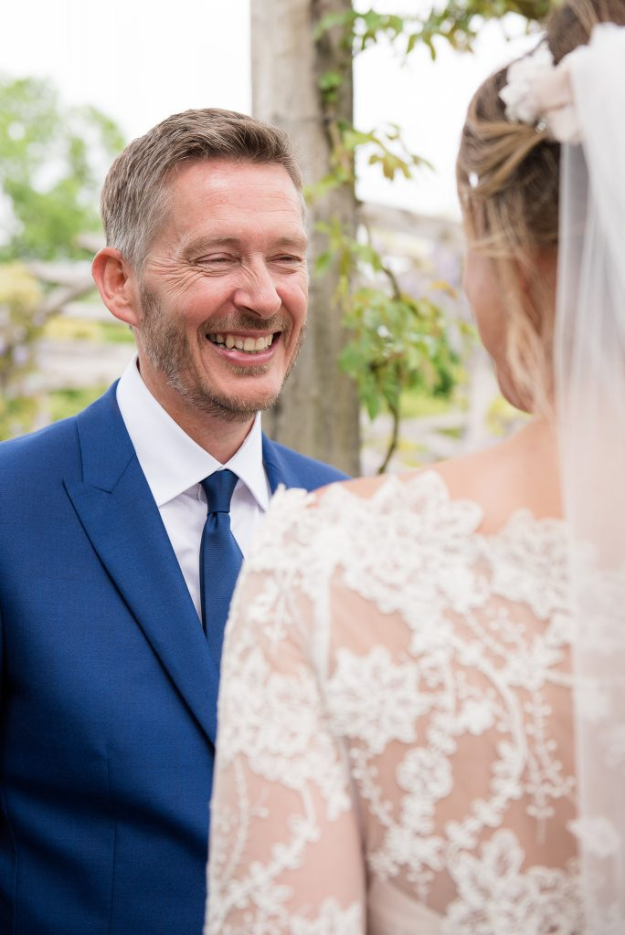 Great Fosters. Natural Documentary Wedding Photography, Surrey. Candid Moment Between Newlyweds in The Great Fosters Garden.