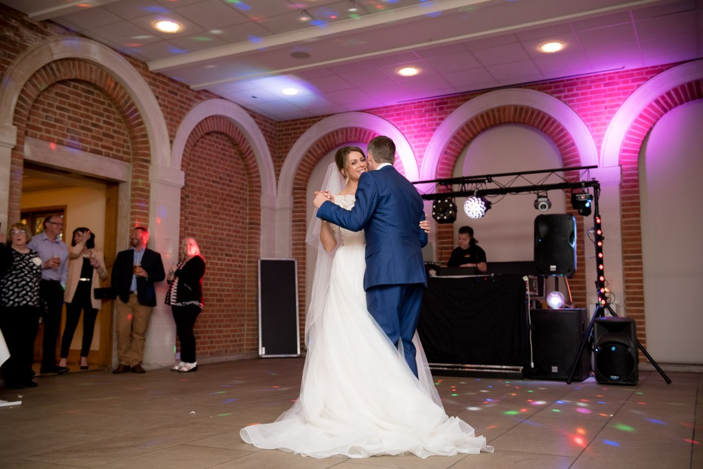 Great Fosters. Natural Documentary Wedding Photography, Surrey. The Bride and Groom Share their First Dance.