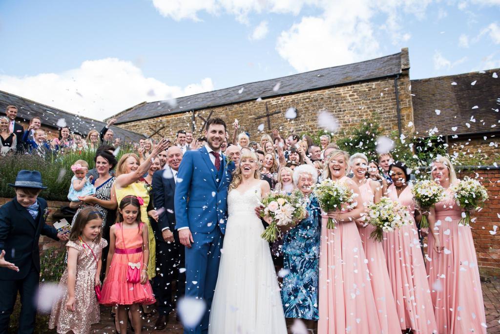 Wedding Confetti, Fun Documentary Wedding Photography Surrey, Couple Cheer as They Walk Down The Confetti Line