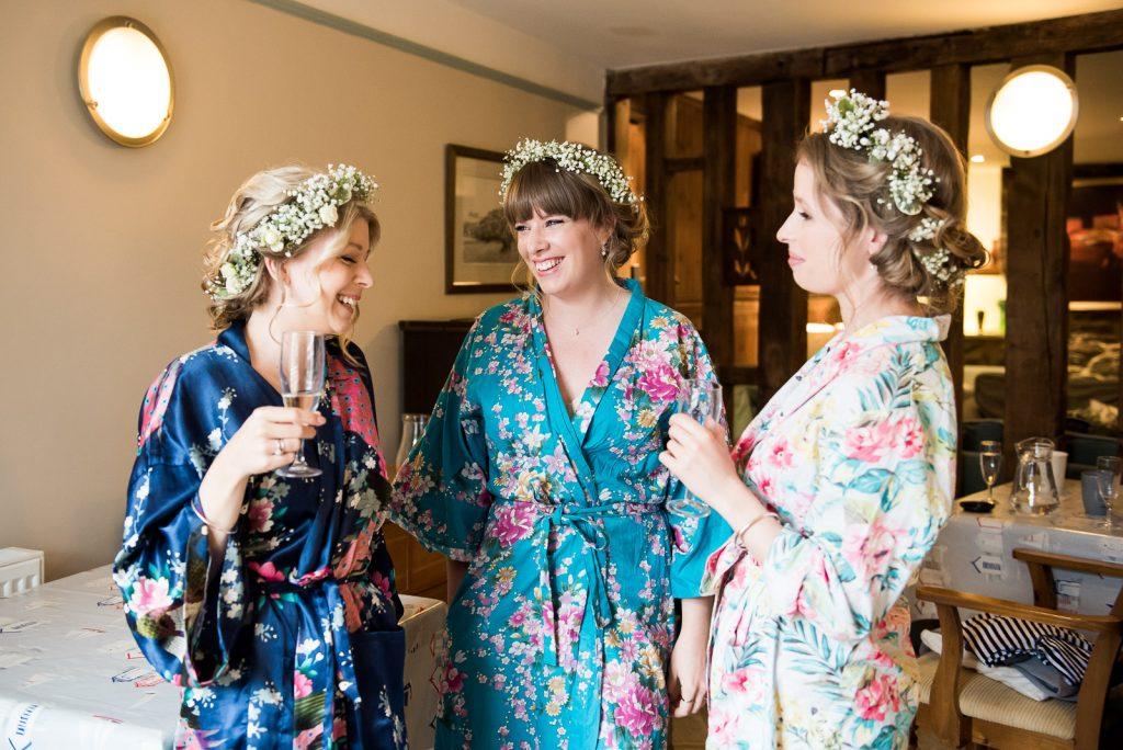 Wedding Day Timeline - Bridesmaids Laughing During Bridal Prep - Outdoor Surrey Wedding