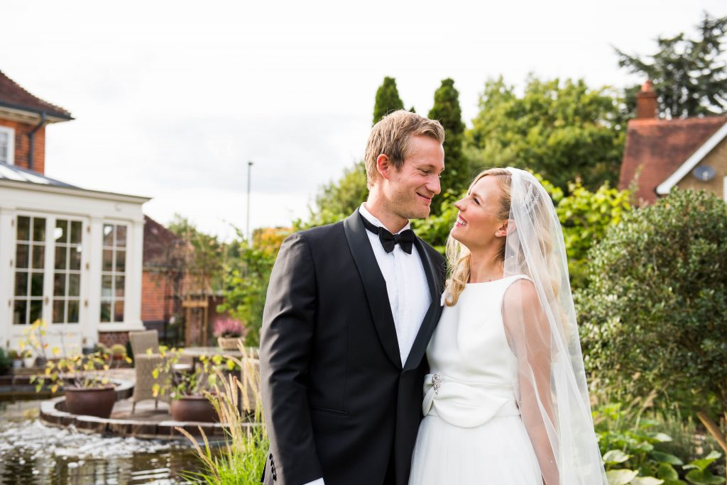 Wedding Day Timeline - Elegant Couple Smile At Each Other - Outdoor Surrey Wedding