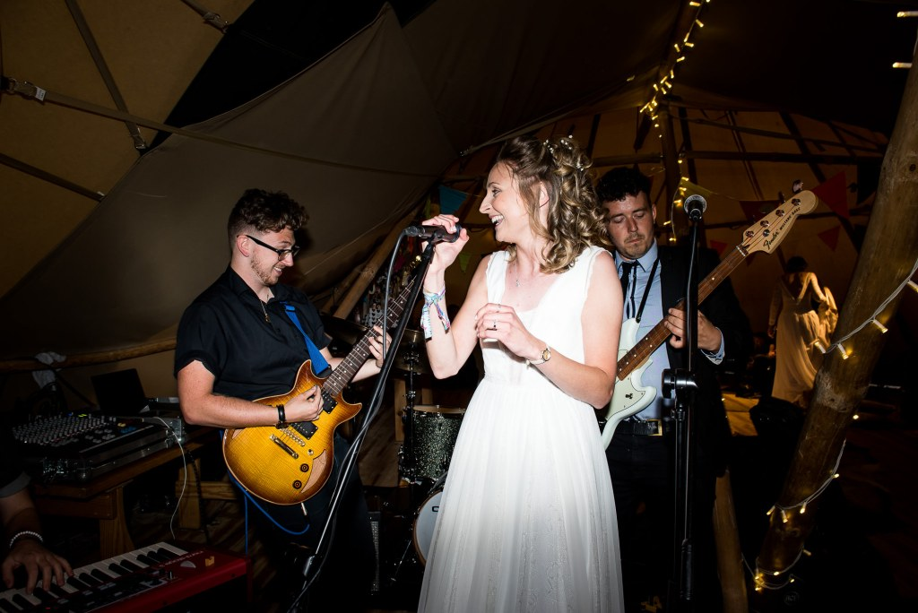 Inkersall Grange Farm Wedding - Same Sex Wedding Photography - Bride Singing With The Wedding Band