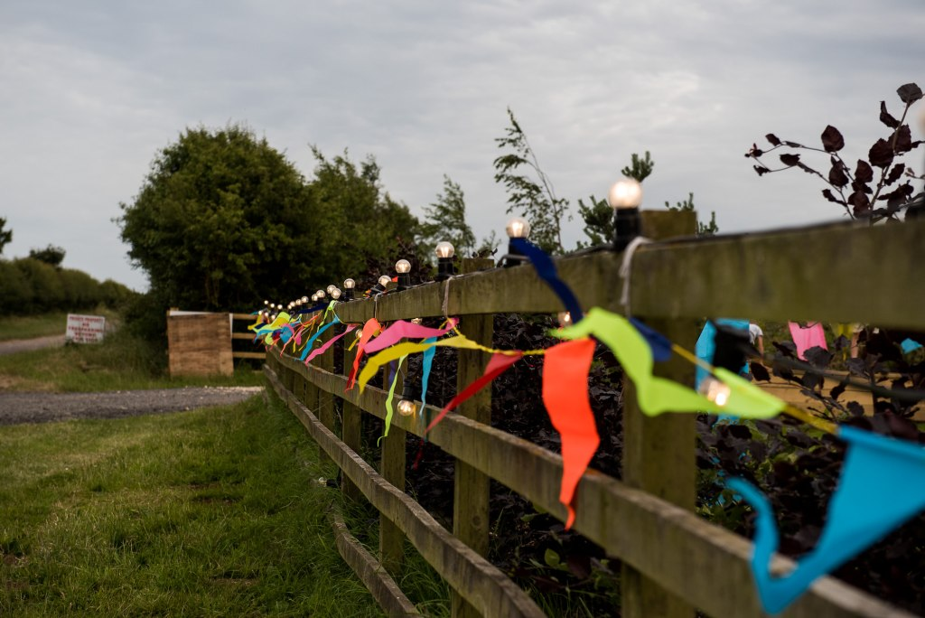 Inkersall Grange Farm Wedding - Same Sex Wedding Photography - Colourful Bunting and Festoon Lights