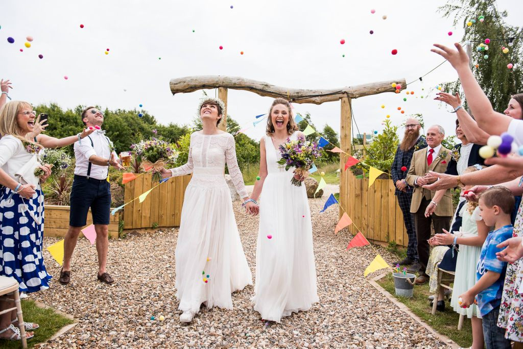 Inkersall Grange Farm Wedding - Same Sex Wedding Photography - Gorgeous Boho Brides Walk Down Pom Pom Confetti Aisle