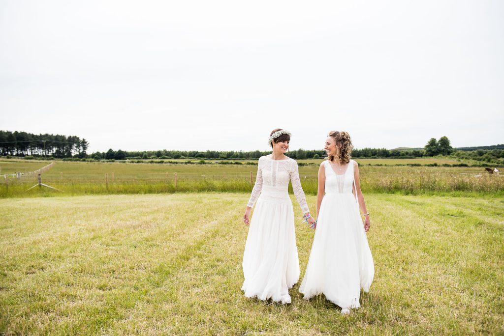 Inkersall Grange Farm Wedding - Same Sex Wedding Photography - Beautiful Boho Brides Walk Together