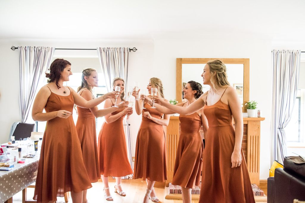 Outdoor Wedding Ceremony, Surrey Wedding Photography, Bridesmaids Cheers with Champagne the Morning of The Wedding