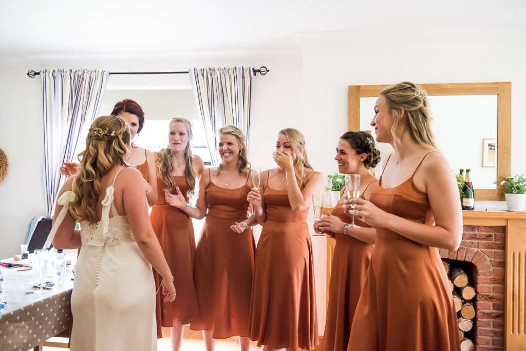 Outdoor Wedding Ceremony, Surrey Wedding Photography, Gorgeous Bride Reveals Her Catherine Deane Bridal Gown To Her Bridesmaids