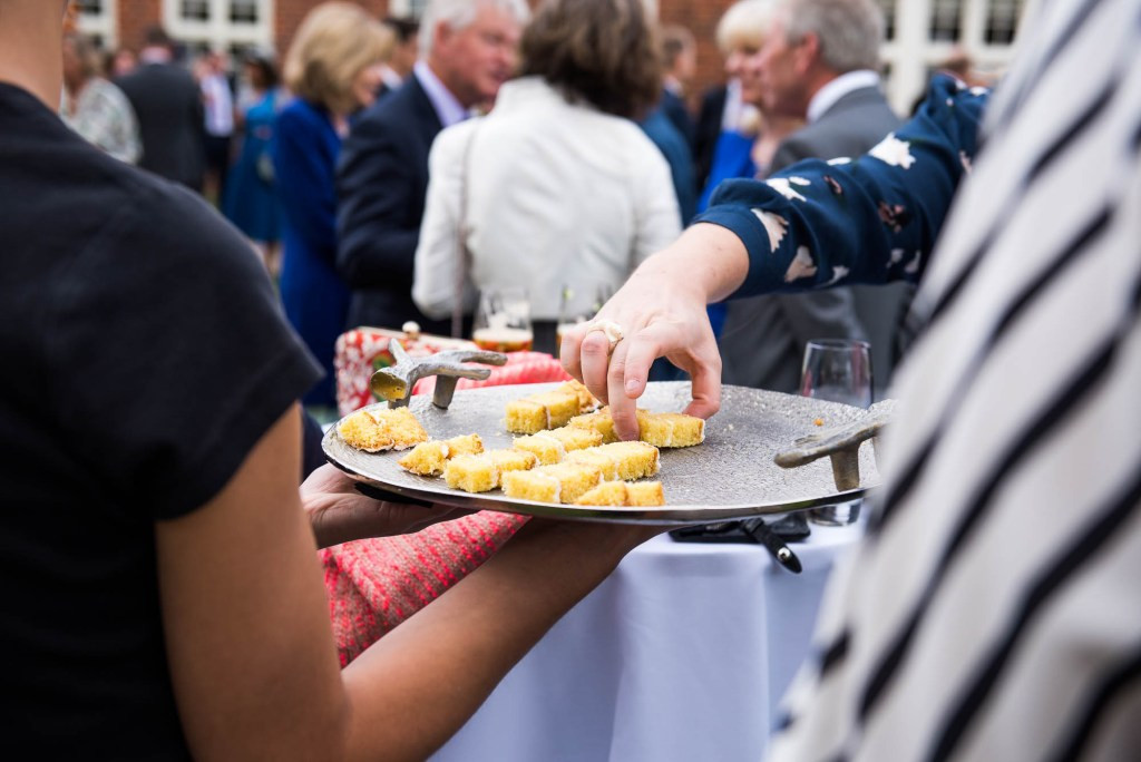 Outdoor Wedding Photography Surrey, Guests Enjoy Wedding Cake