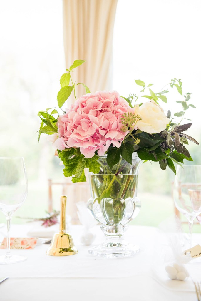 Outdoor Wedding Photography Surrey, Large Pink Hydrangea Flower Display with Traditional Danish Gold Bell