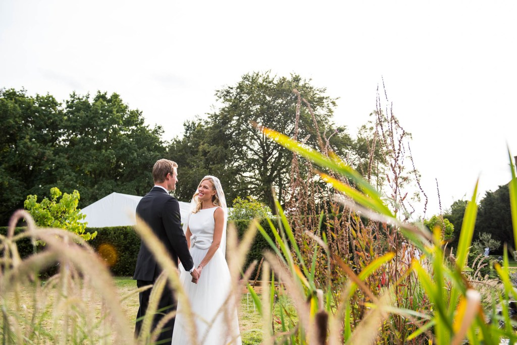 Outdoor Wedding Photography Surrey, Bride and Groom Stare Lovingly At Each Other Bathed in Golden Evening Light, Surrey Wedding Photography