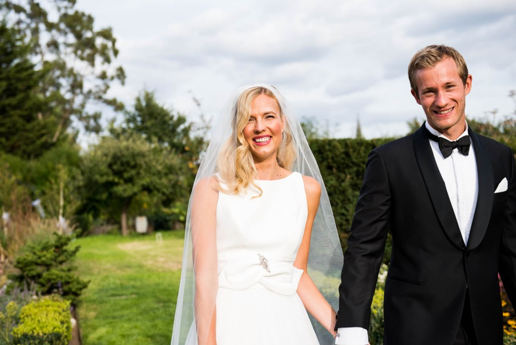 Outdoor Wedding Photography Surrey, Elegant Bride Smiling Naturally In The Sunshine