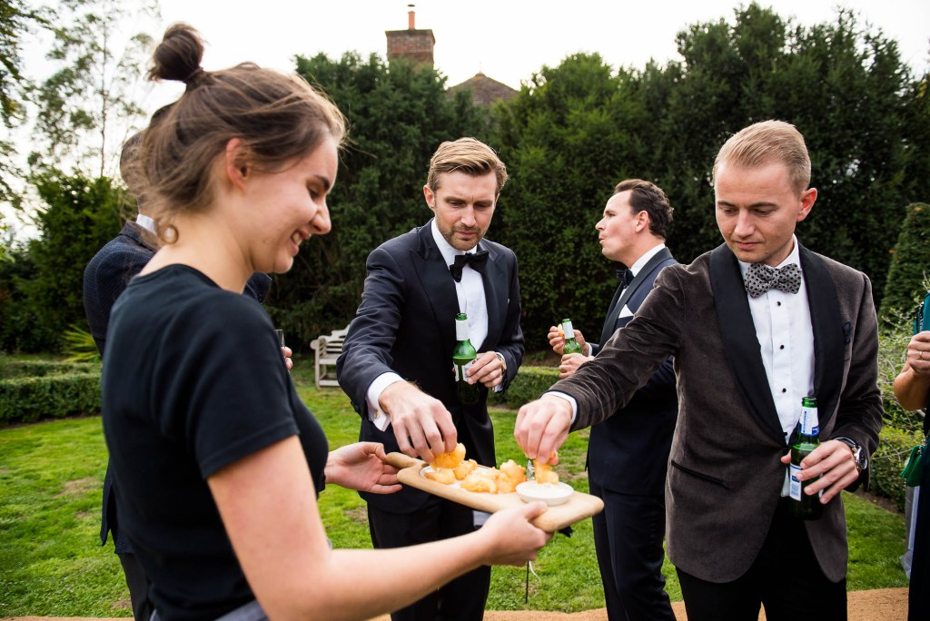 Outdoor Wedding Photography Surrey, Glamorous Wedding Guests Enjoy Catered Food From Kalm Kitchen