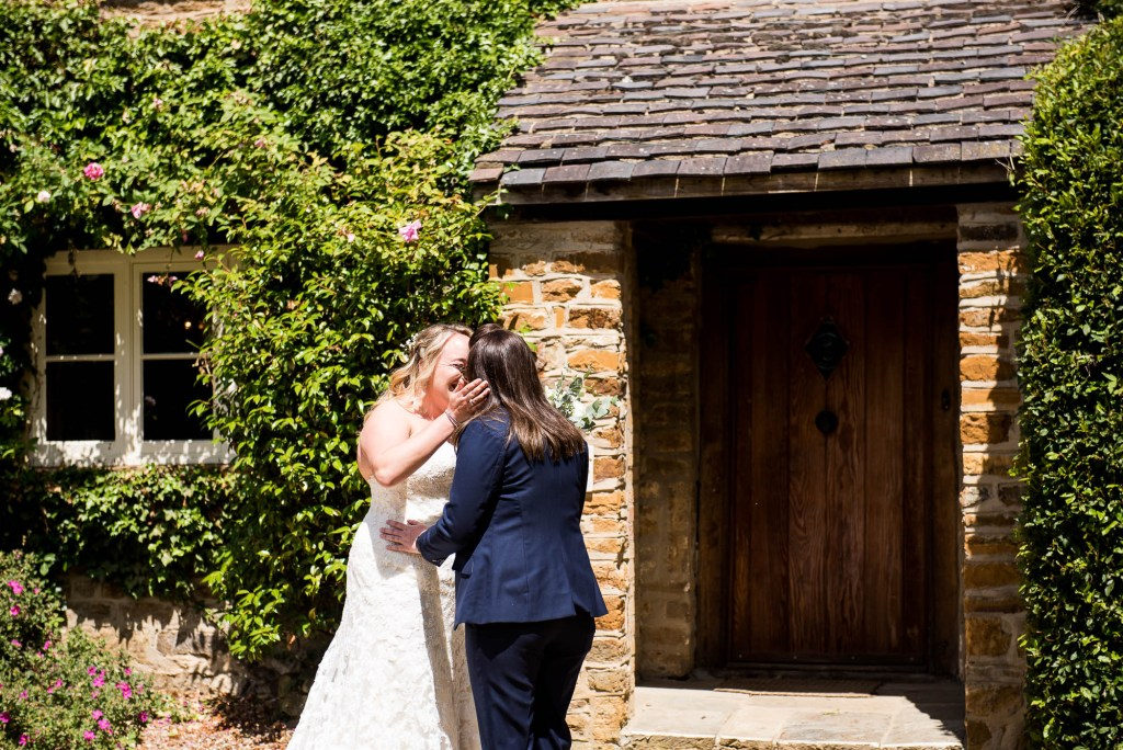 lgbt wedding photographer, Brides meet in the sunshine for an emotional first look
