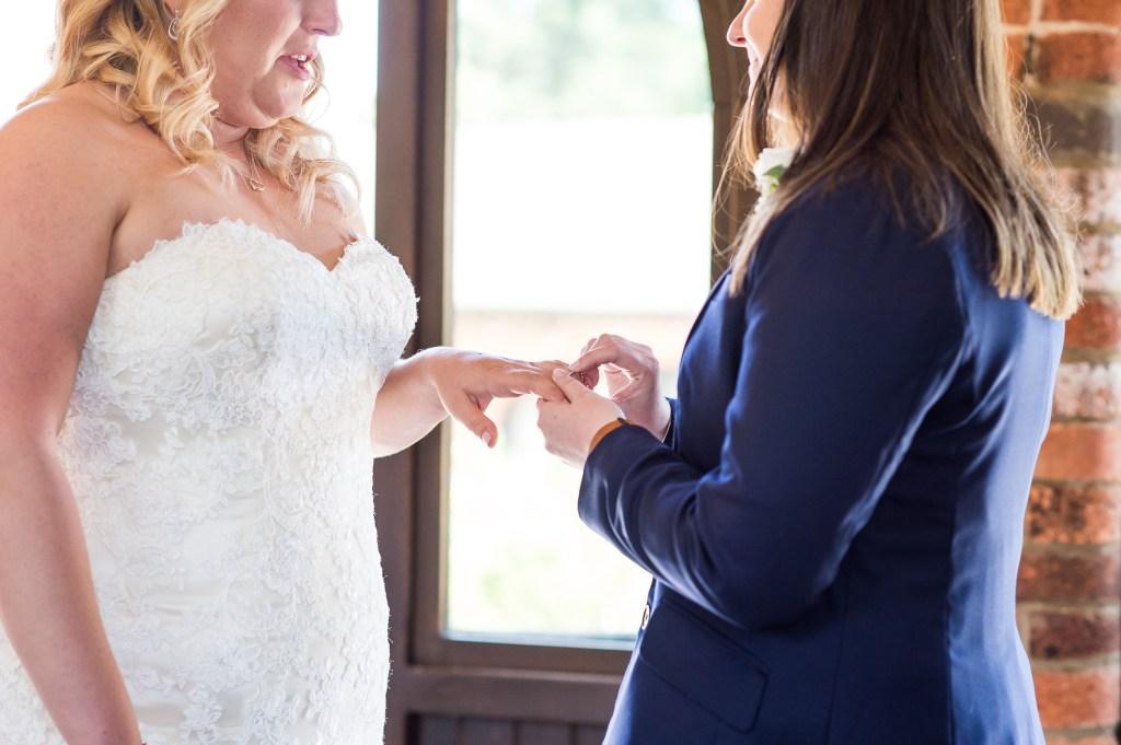 lgbt wedding photographer, brides exchange rings in same sex ceremony