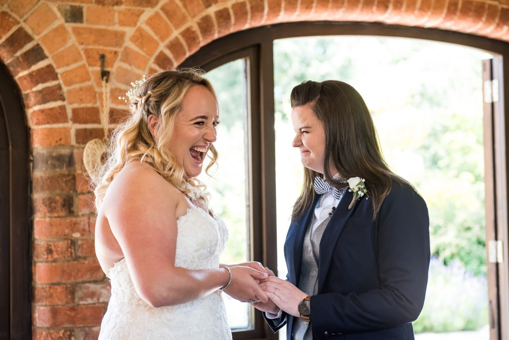 lgbt wedding photographer, Brides say their vows in gorgeous wedding ceremony at Dodmoor House