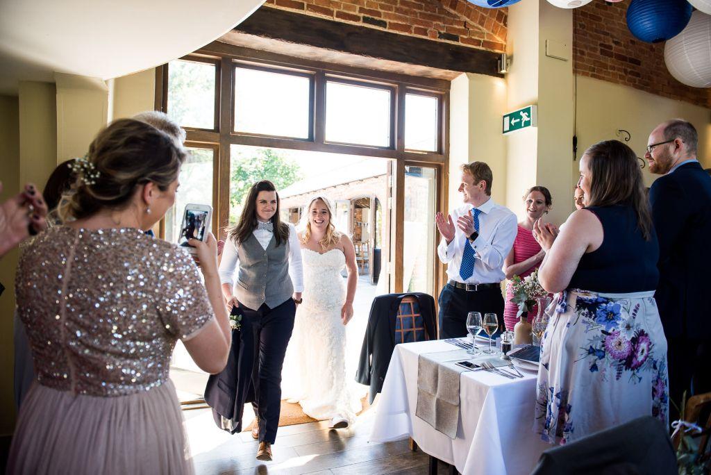 lgbt wedding photographer, brides are announced into their wedding breakfast