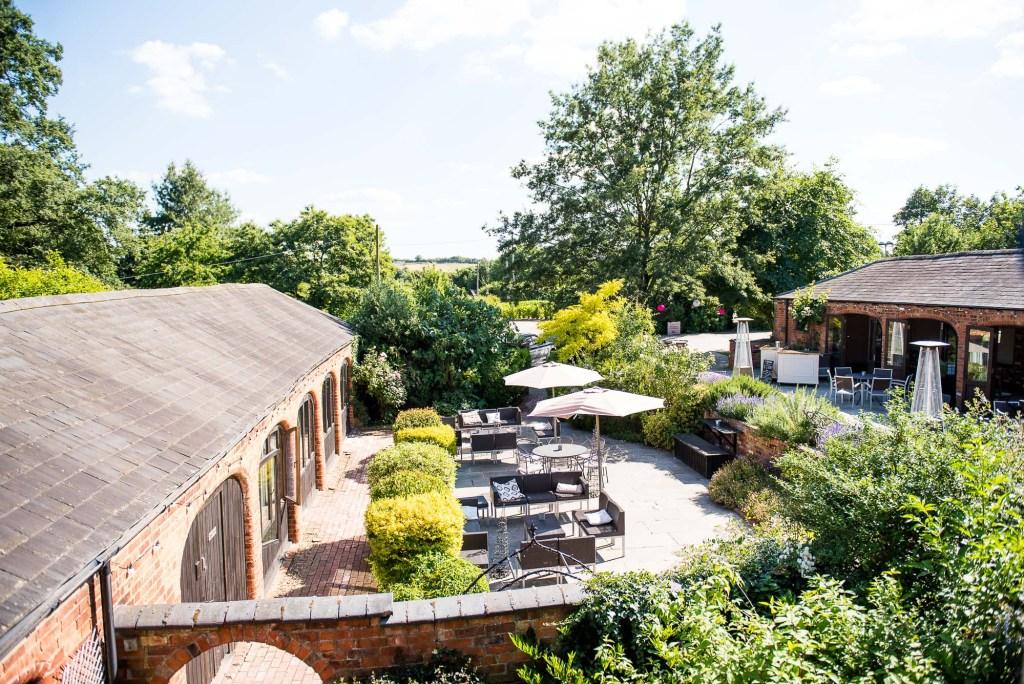 lgbt wedding photographer, Dodmoor House Wedding Venue courtyard in the sunshine