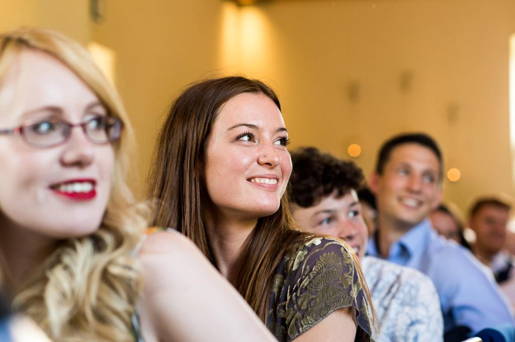 lgbt wedding photographer, wedding guest candid reactions during speeches