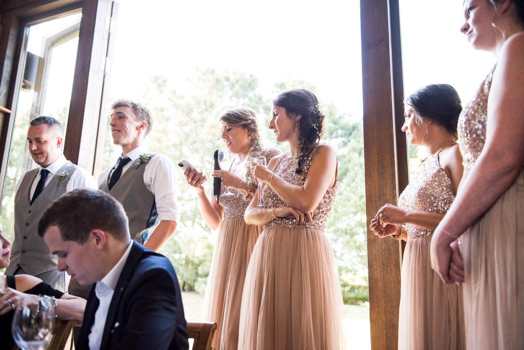 lgbt wedding photographer, bridesmaids give a speech, Dodmoor House Wedding