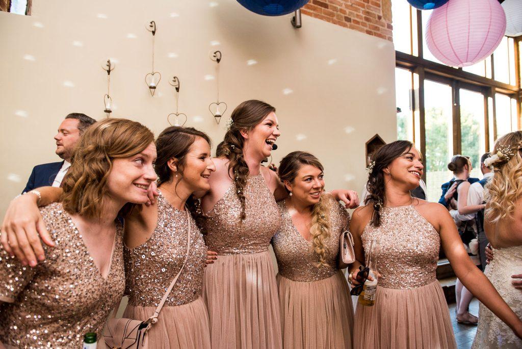 lgbt wedding photographer, bridesmaids share a dance on the dancefloor