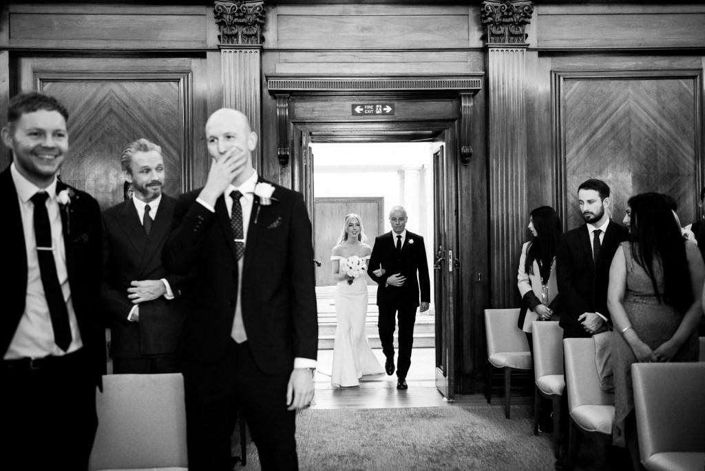 Old Marylebone Town Hall Wedding, groom's reaction as bride walks down the aisle
