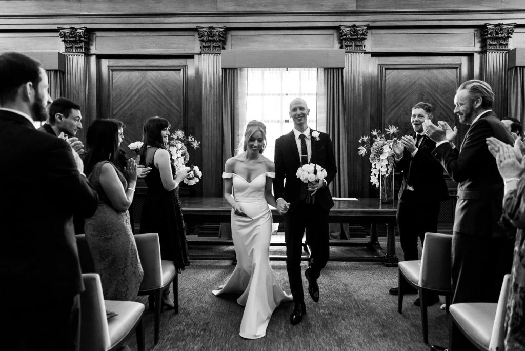 Old Marylebone Town Hall Wedding, Bride and groom walk down the aisle as a married couple