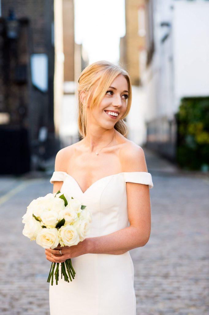 Old Marylebone Town Hall Wedding, bride in traditional off the shoulder Sherri Hill wedding dress