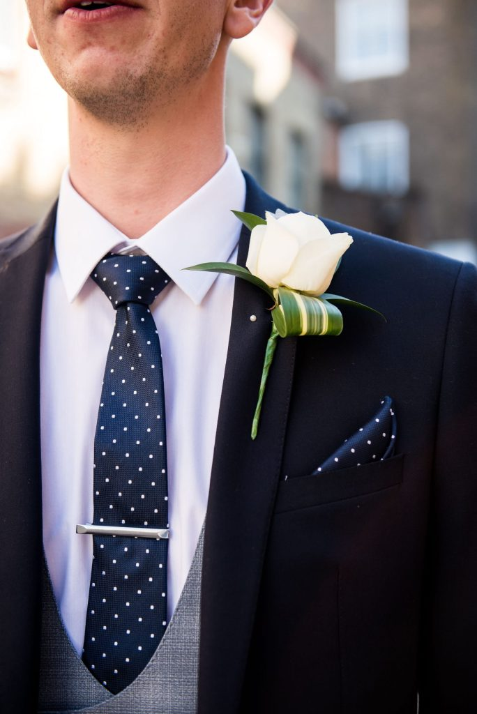 Old Marylebone Town Hall Wedding, stylish single white rose buttonhole