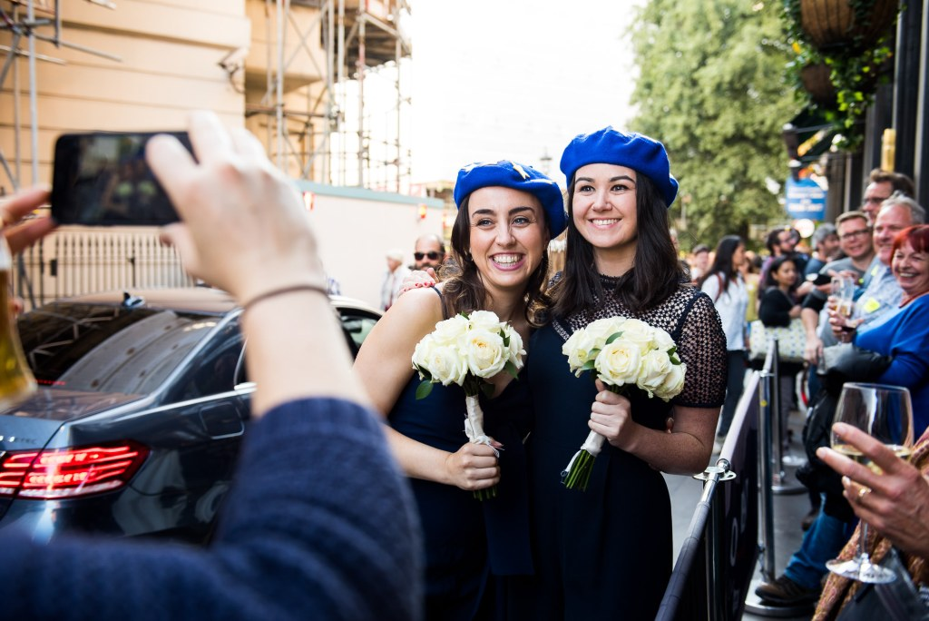 Old Marylebone Town Hall Wedding, bridesmaids wear EU hats for the anti-Brexit march