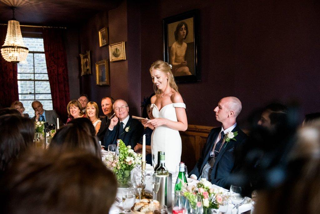 Old Marylebone Town Hall Wedding, bride in a sleek and stylish wedding dress gives emotional wedding breakfast speech