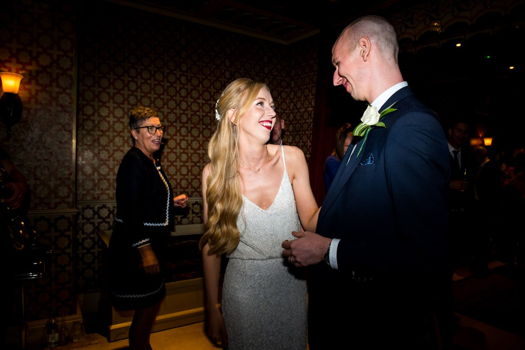 Old Marylebone Town Hall Wedding, stylish bride and groom share first dance