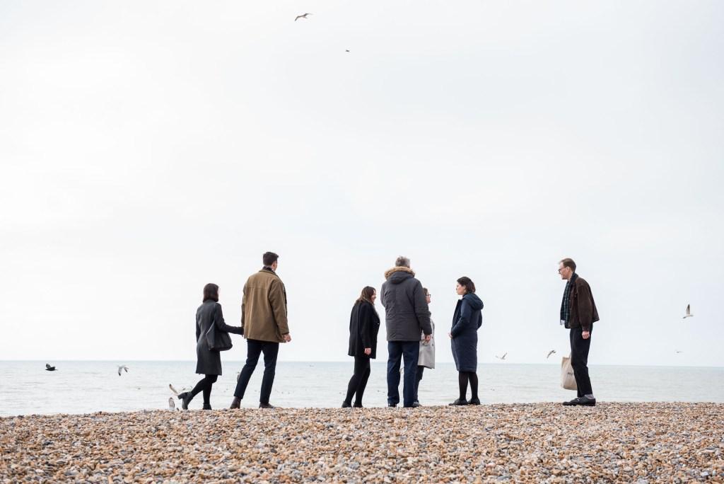 LGBT wedding photography, family walk on Brighton beach together