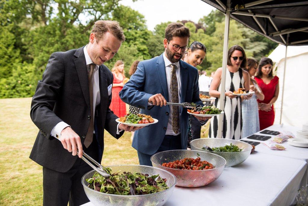 Alternative wedding photography - outdoor wedding breakfast paella catering