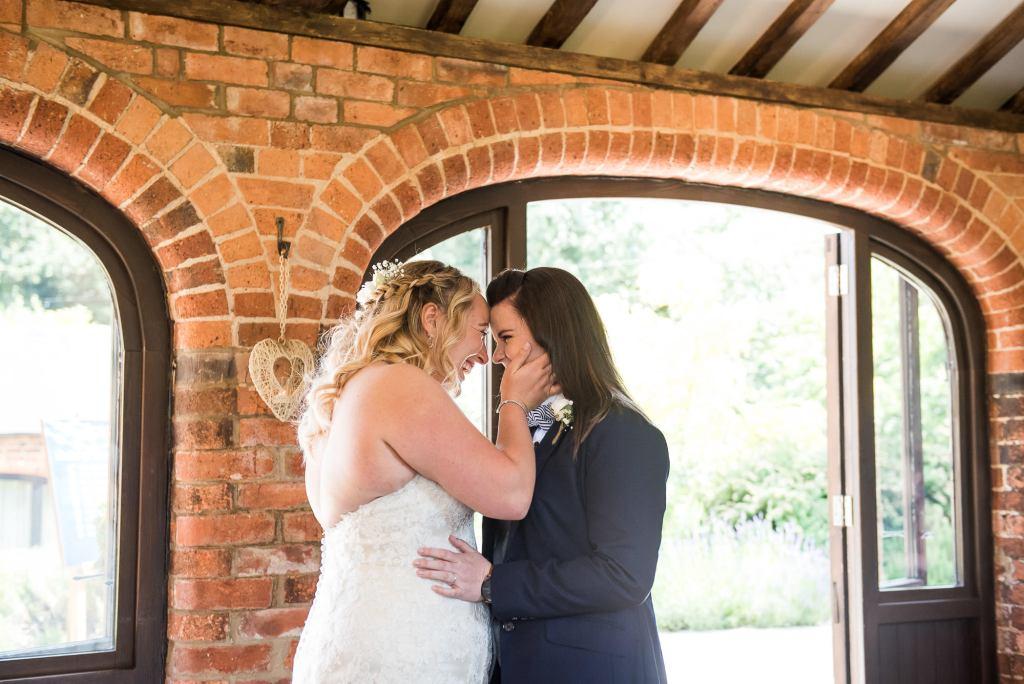 Alternative wedding photography - couple embrace during wedding ceremony