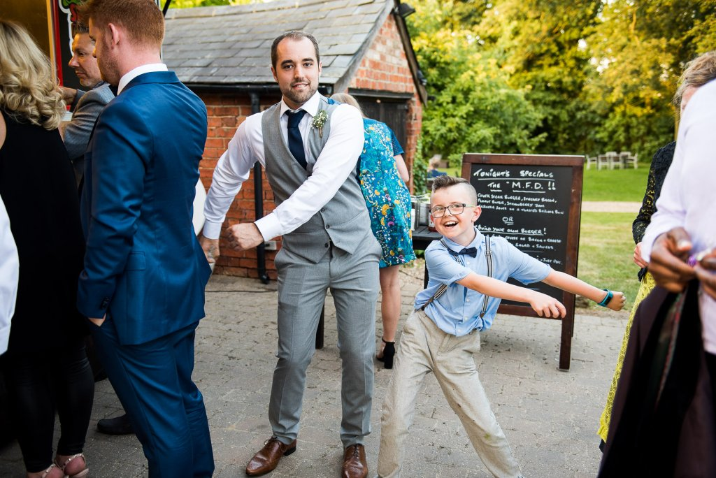 LGBT wedding photography, wedding guests dance the floss