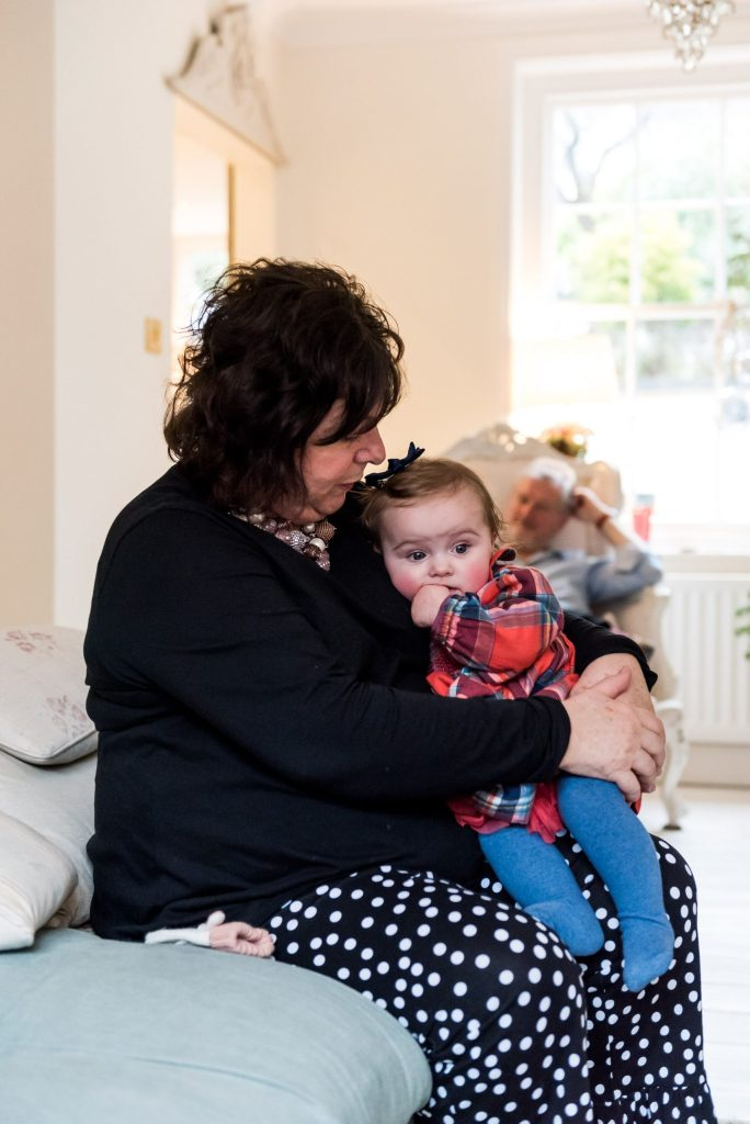 London Family Photography, Grandmother and granddaughter share a cuddle together