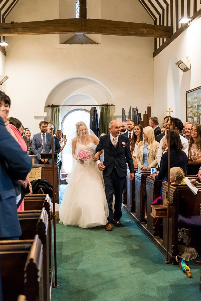 st martha's wedding, bride and father walk together down the aisle